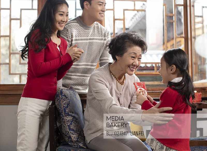 Happy family celebrating Chinese New Year