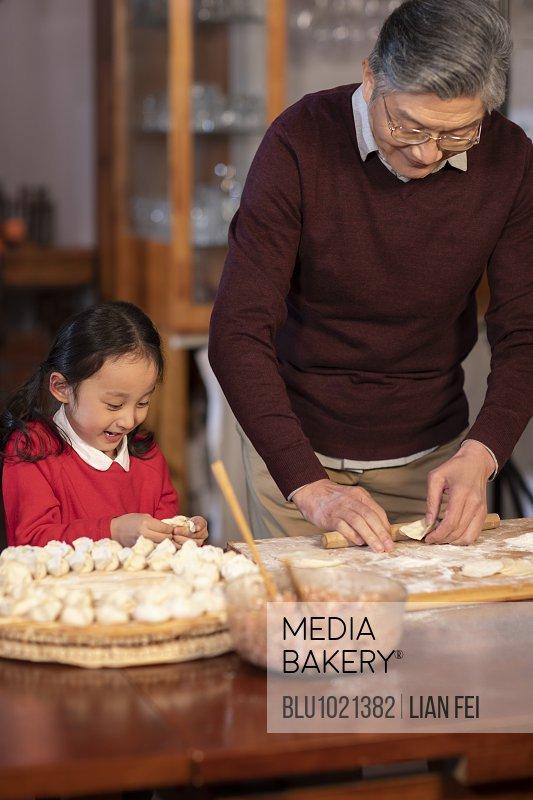 Happy family making dumplings