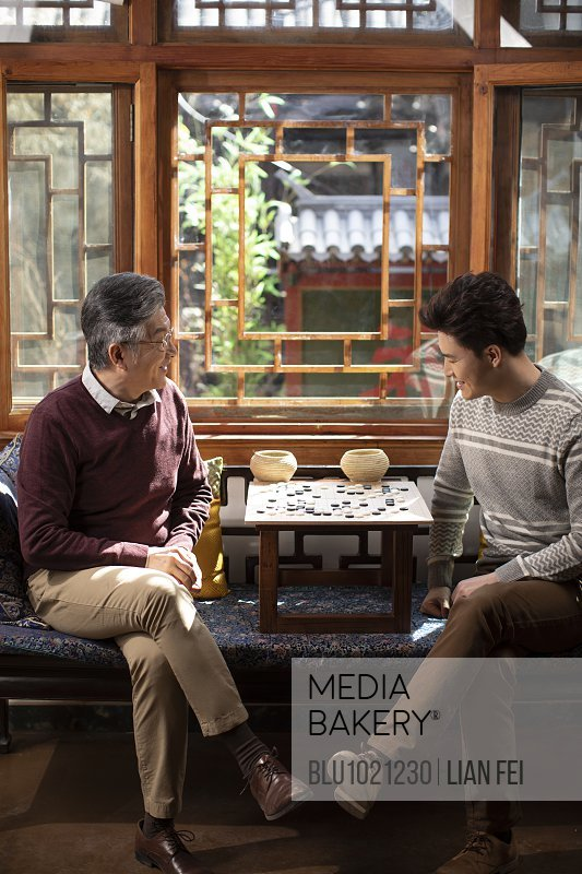 Happy father and son playing the game of go