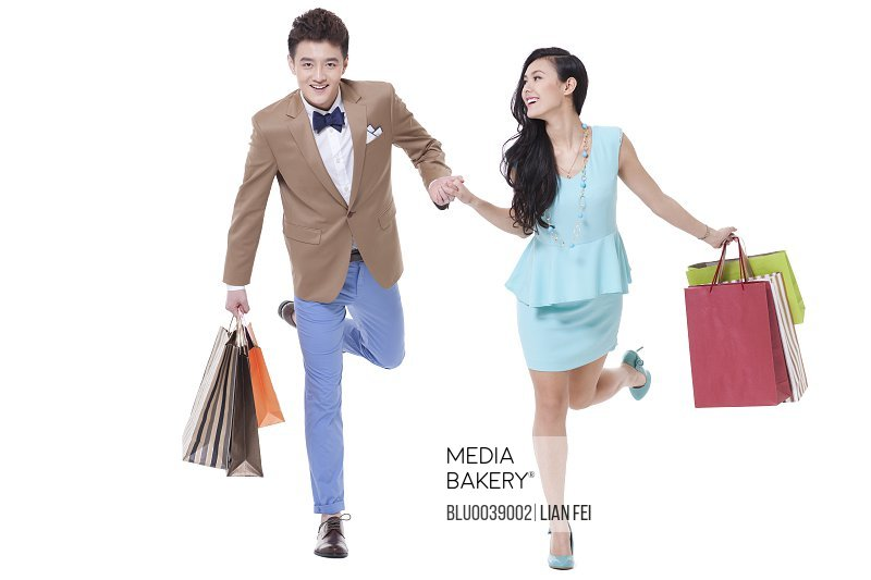 Fashionable young couple shopping with excitement