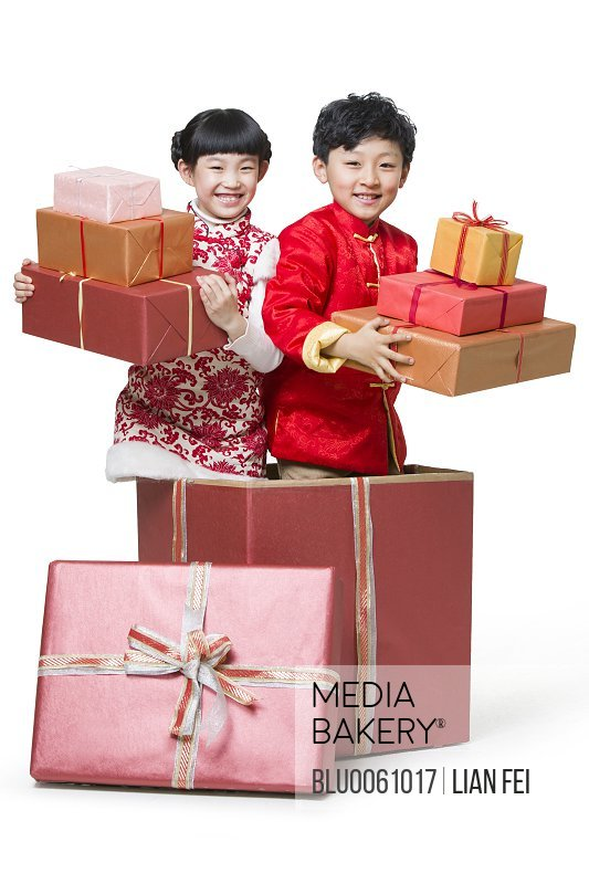 Happy children holding many Chinese new year gifts