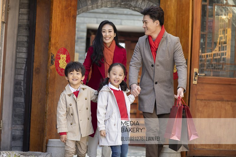 Happy young family celebrating Chinese New Year