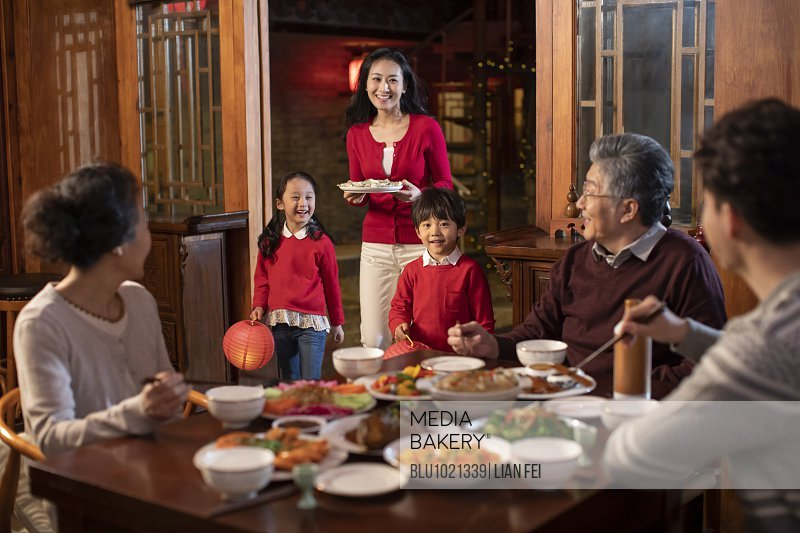 Happy family preparing dinner for Chinese New Year