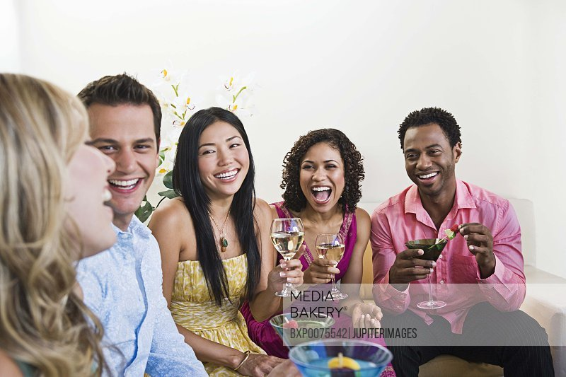 Smiling friends with alcoholic beverages