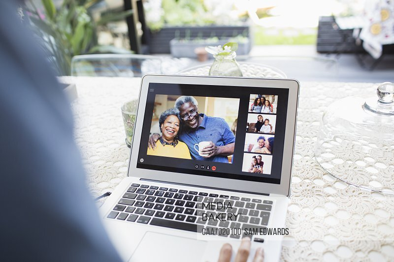 Family and friends video conferencing on laptop screen