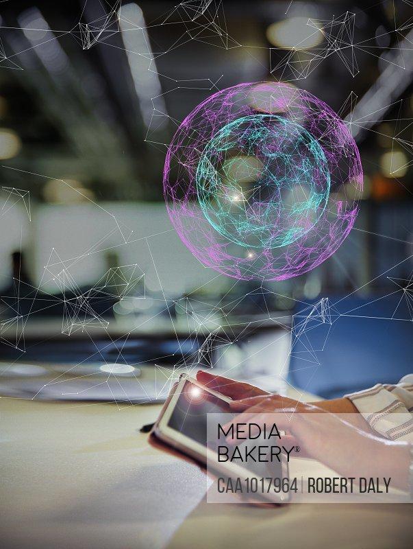 Digital globe above businesswoman suing digital tablet