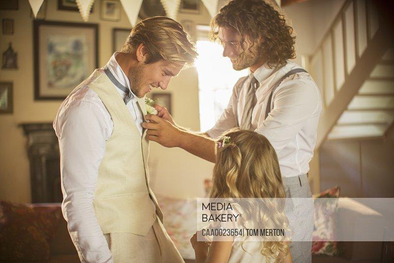Bridegroom and best man preparing for wedding ceremony