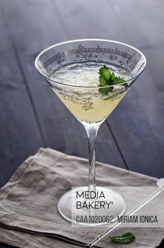Gin lime mint cocktail in decorative glass