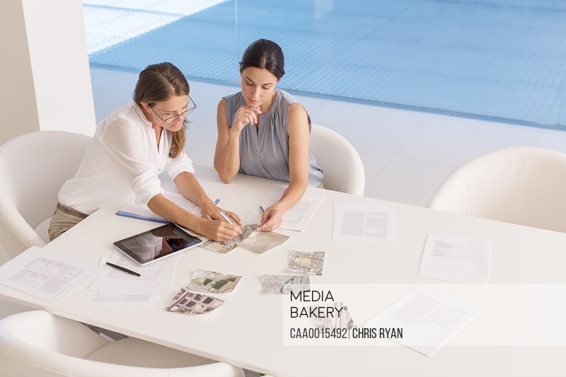 Businesswomen meeting at conference table