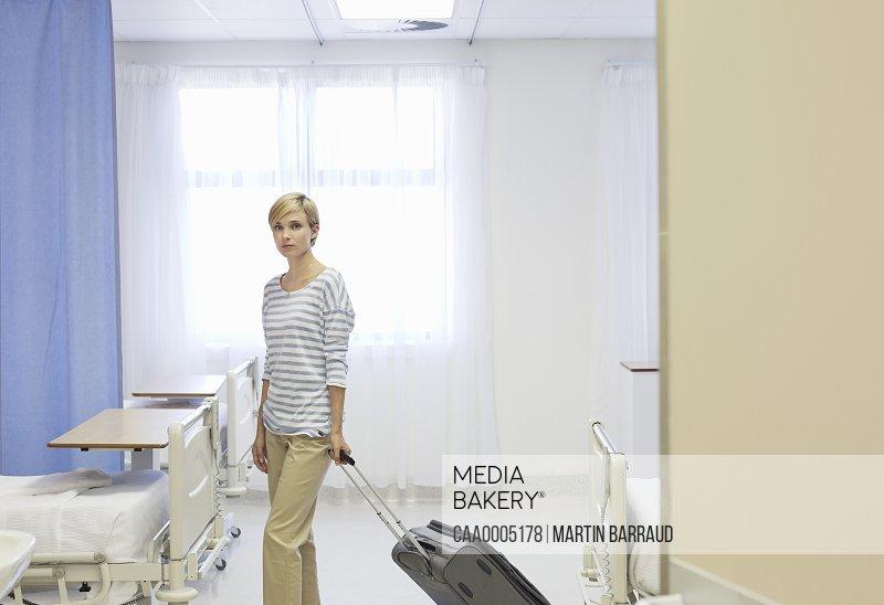 Patient leaving hospital room