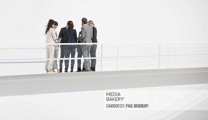 Business people meeting on elevated walkway