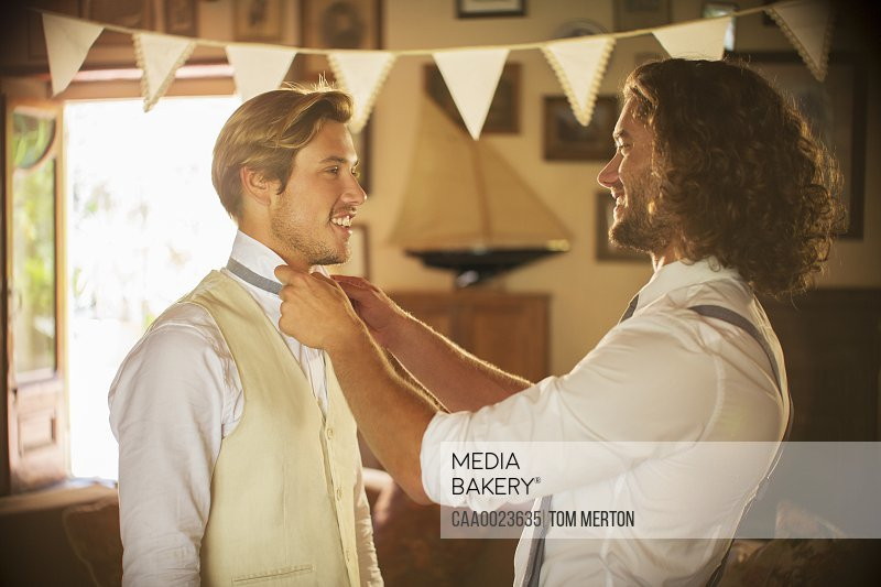Bridegroom and best man preparing for wedding ceremony