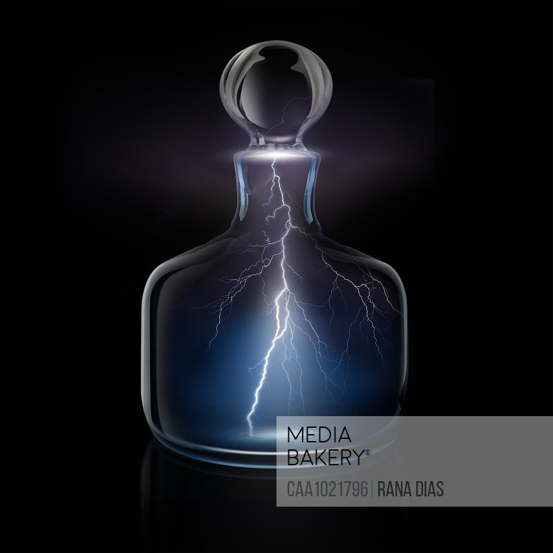 Lightning bolts in glass decanter