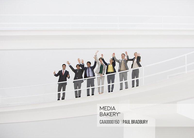 Portrait of cheering business people on elevated walkway