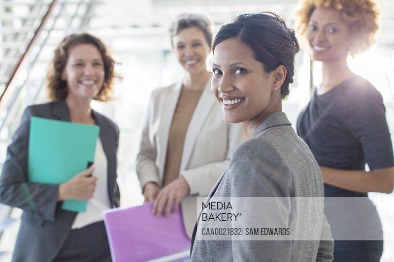 Portrait of four smiling businesswomen in office