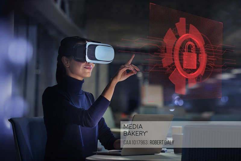 Businesswoman with virtual reality glasses looking at virtual screen