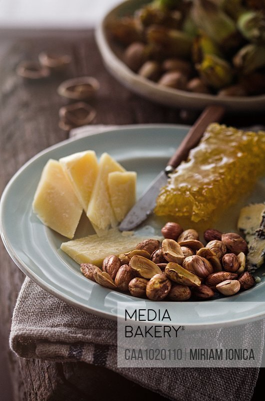 Cheese platter with honeycomb and hazelnuts