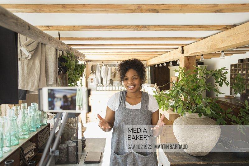 Plant nursery owner filming vlog inside shop