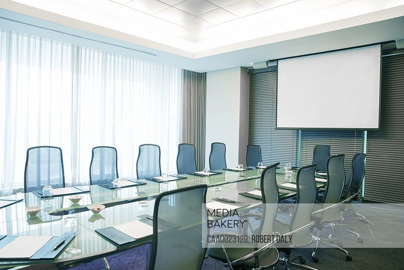 Empty conference room with modern glass table