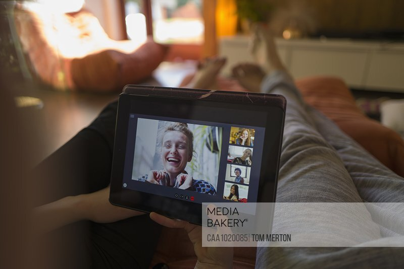 POV friends video conferencing on digital tablet screen