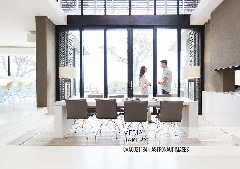 Couple talking in modern dining room