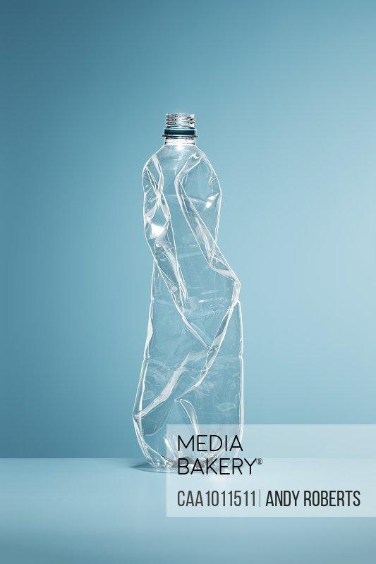 Crumpled, empty plastic water bottle