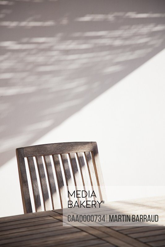 Wooden table and chair in sunlight
