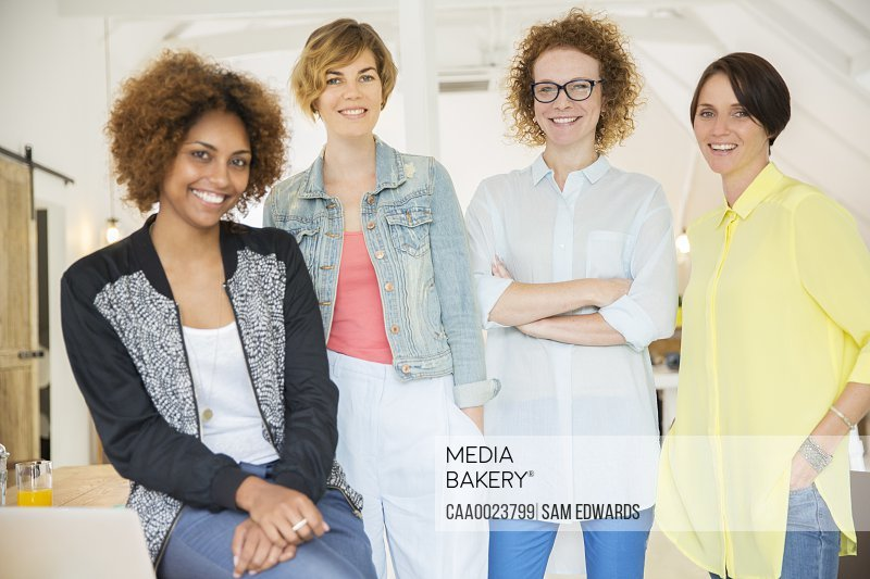Group of smiling women at work
