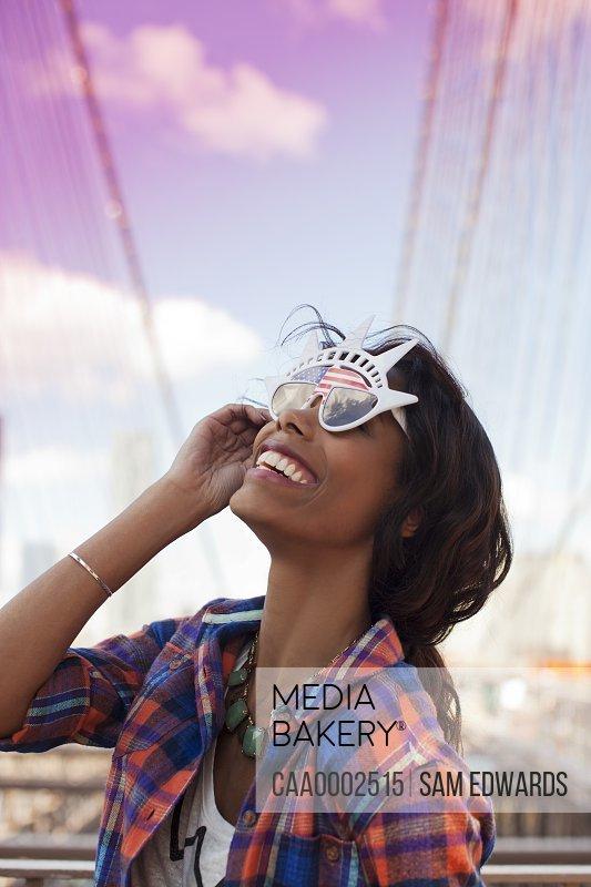 Woman wearing novelty sunglasses outdoors