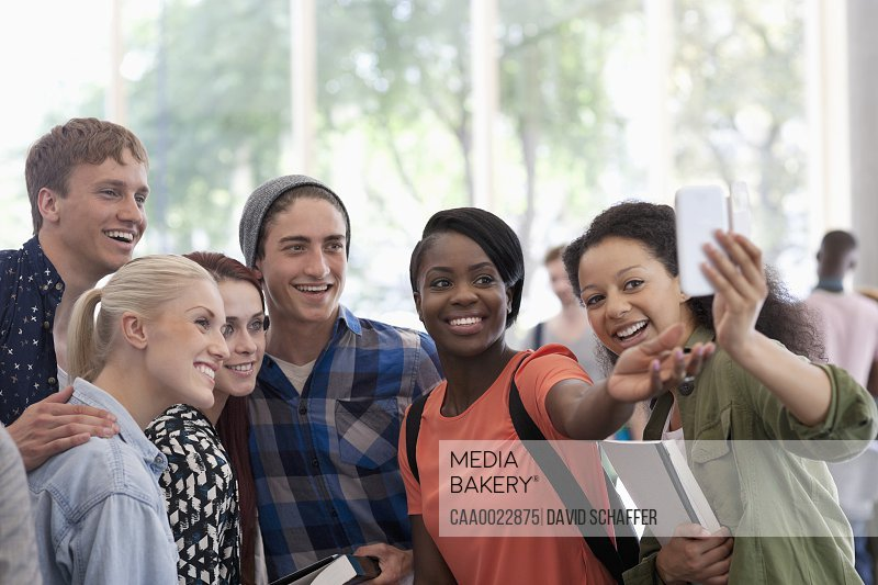 University students taking selfie in corridor during break