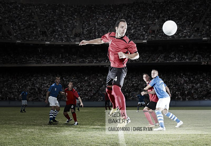 Soccer player jumping on field