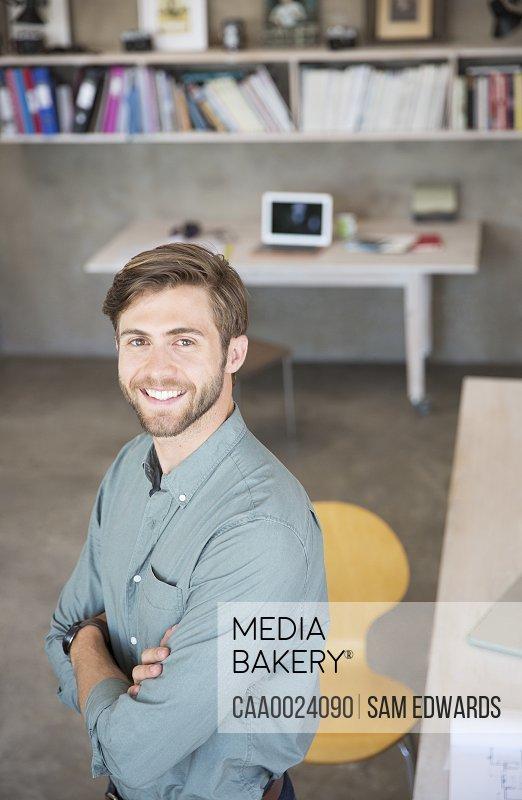 Portrait of young blonde man standing in studio