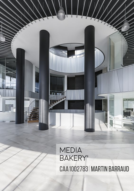 Photo by Caia Images - Architectural, modern office lobby