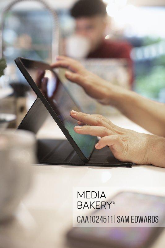 Close up man using digital tablet