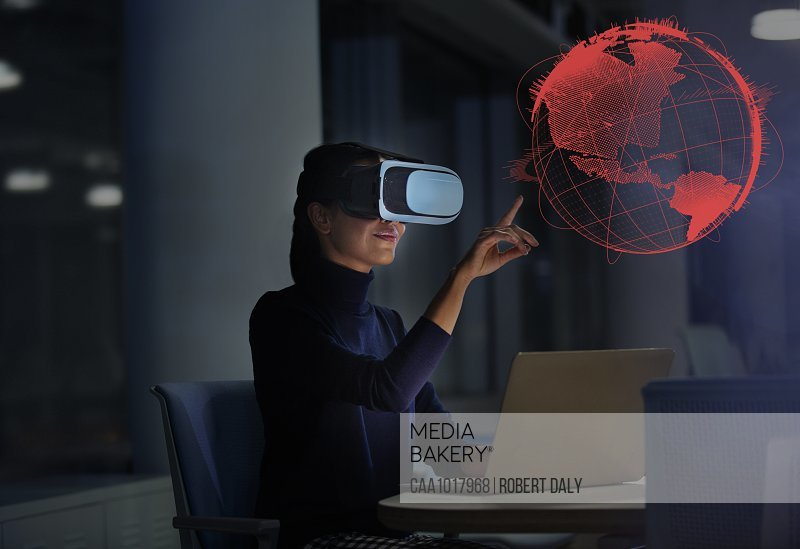Businesswoman with virtual reality glasses touching virtual globe