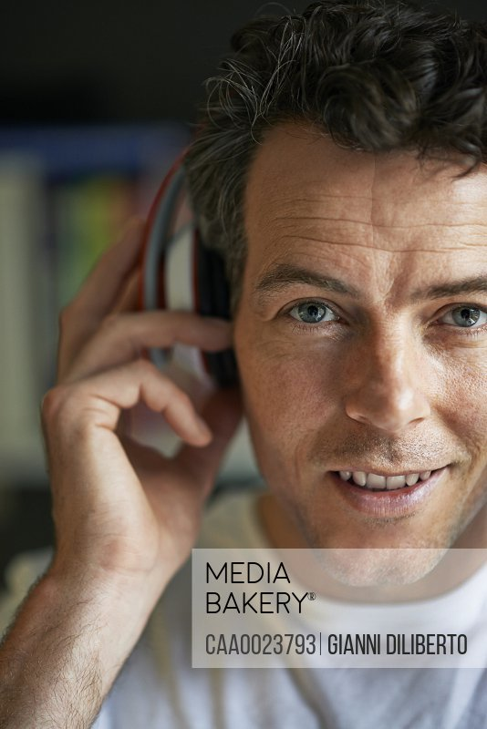 Smiling man with headphones on close up