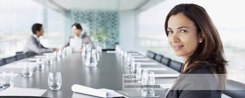 Portrait of smiling businesswoman in conference room