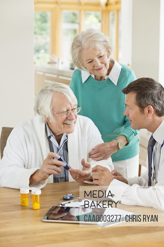 Doctor talking with older patient wife