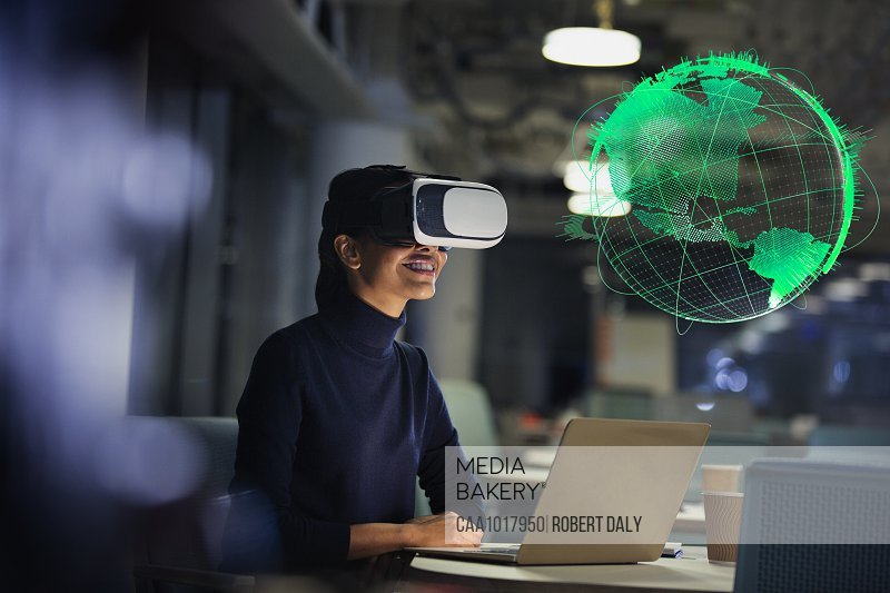 Businesswoman with virtual reality glasses looking at globe