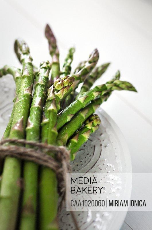 Close up bundled fresh green asparagus