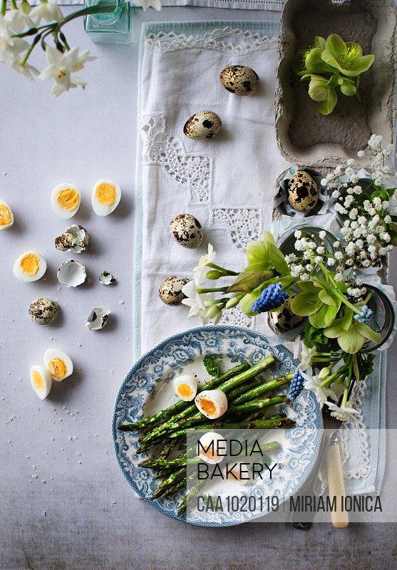 Asparagus and quail eggs on Easter table