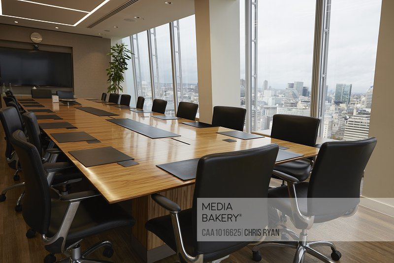 Modern conference room table overlooking city