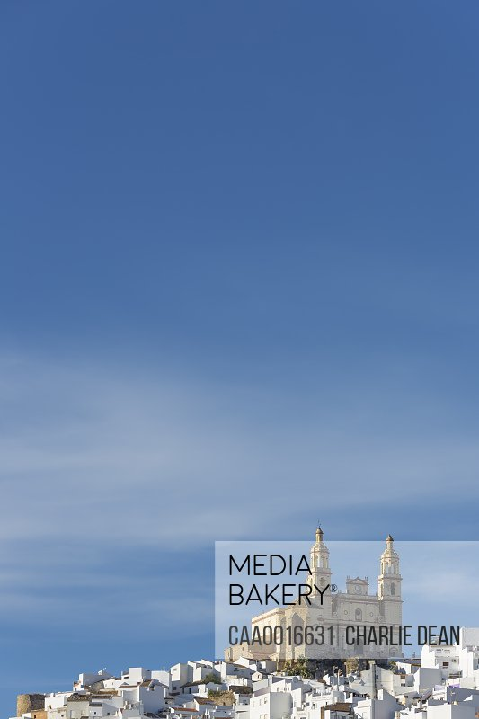 Parish of our Lady of the Incarnation on hilltop under blue sky, Olvera, Andaluc'a, Spain