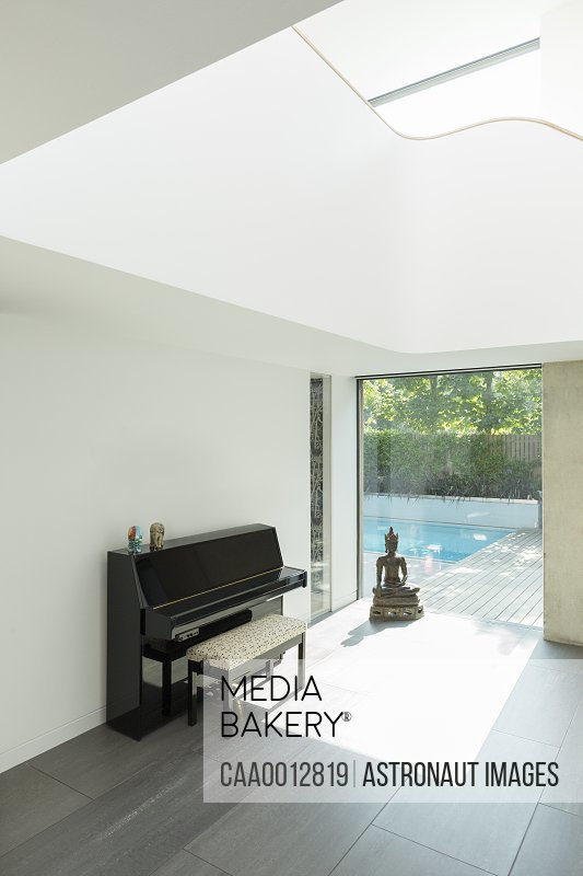 Piano and Buddha statue in modern house