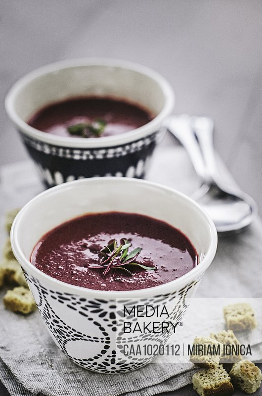 Beetroot soup in cups with bread croutons