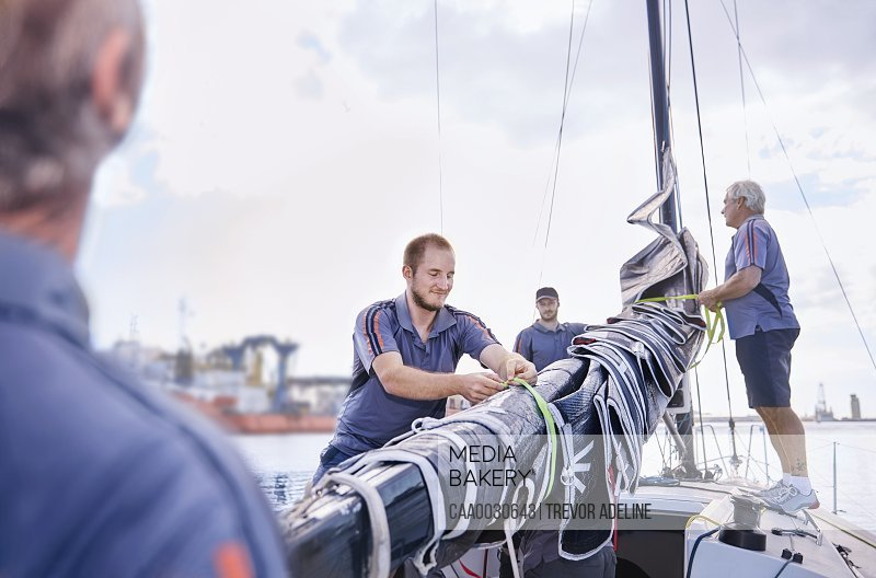 Men preparing sailing equipment