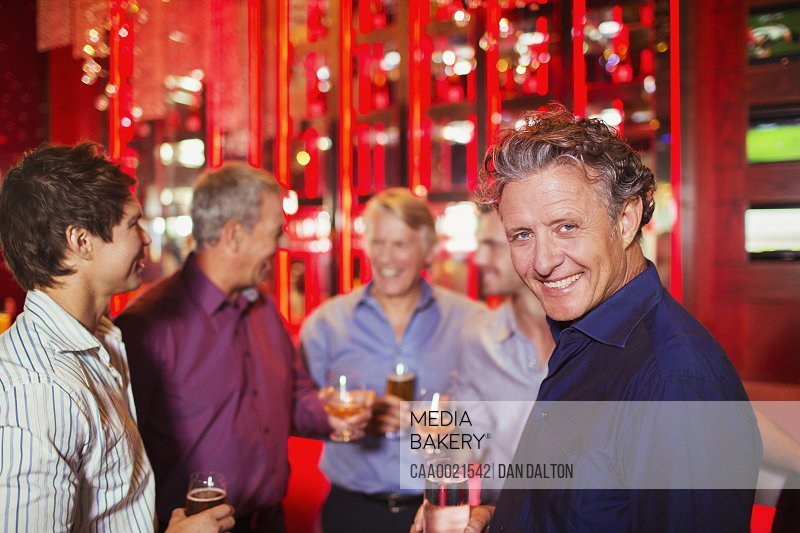 Men enjoying themselves at party