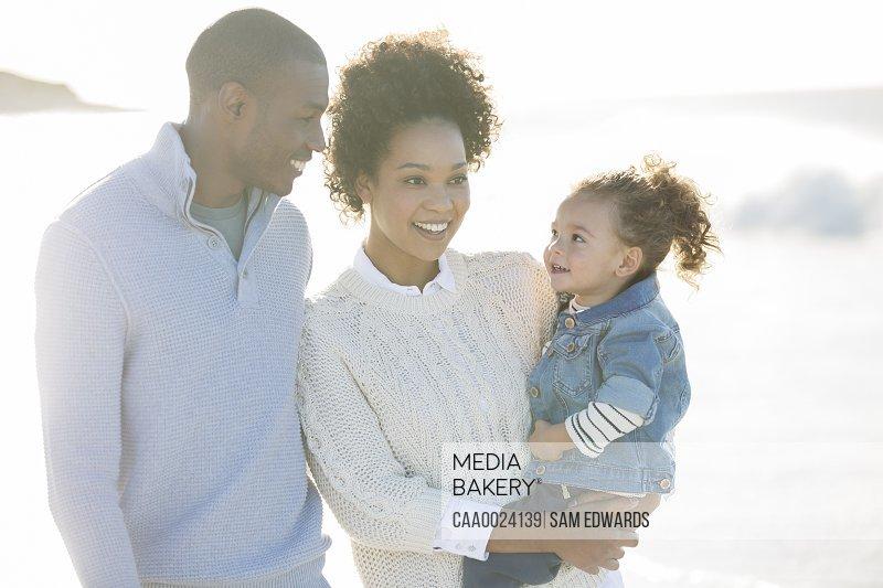 Portrait of happy family in sunlight