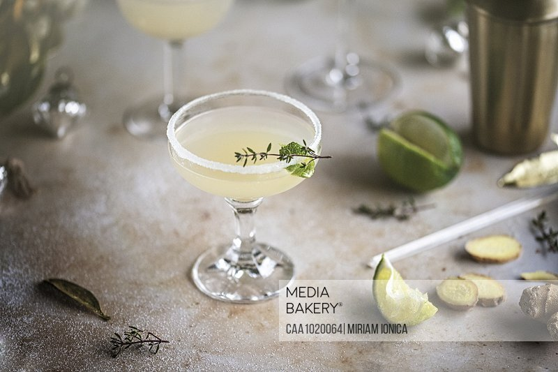 Ginger lime cocktail with herb garnish