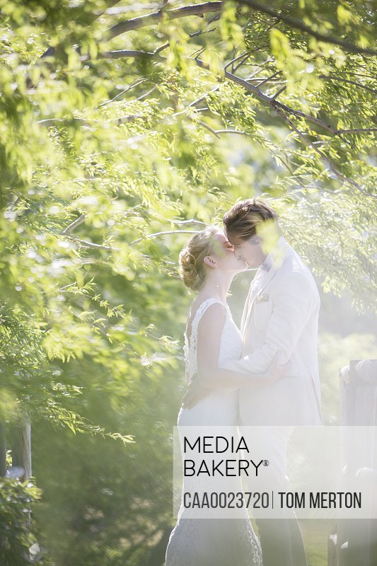 Young couple kissing in domestic garden